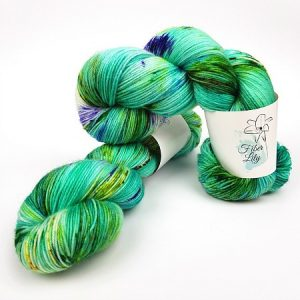 Elixir hand dyed yarn by Fiber Lily Australia variegated speckled aqua green yellows and browns 4