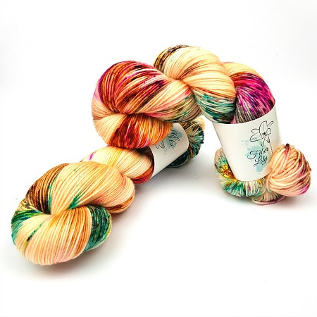 Polly hand dyed yarn by Fiber Lily Australia apricot with aqua blue, gold, fuchsia and brown speckles non mulesed Australian wool