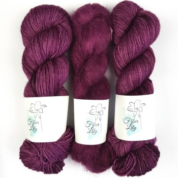 Reign hand dye yarn by Fiber Lily Australia magenta semi solid tonal colourway sock yarn and mohair silk