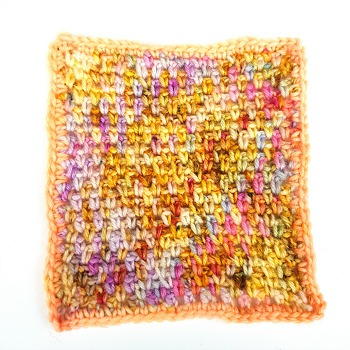 Am I only dreaming hand dyed yarn by Fiber Lily Australia pink purple yellow orange blue speckled wool crochet sample