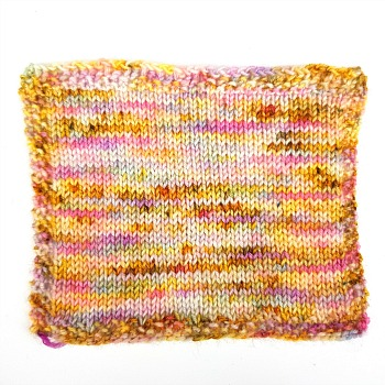Am I only dreaming hand dyed yarn by Fiber Lily Australia pink purple yellow orange blue speckled wool knit sample