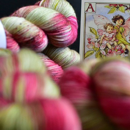 Apple Blossom Fairy A Fiber Lily hand dyed yarn Australia Flower Fairies colourway pink, red, green variegated with brown and blue speckles colourway3