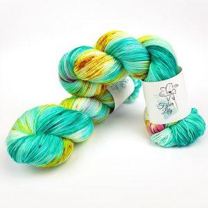 carousel hand dyed yarn by Fiber Lily Australia aqua blue, gold and pink variegated speckled wool for knitting and crochet