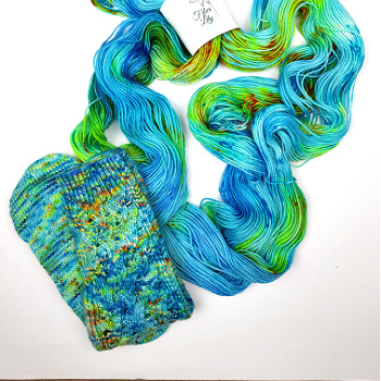 Just keep swimming hand dyed yarn by Fiber Lily Australia blue speckled wool for knitting and crochet swatch