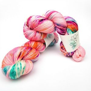 Cosmos Fleur hand dyed yarn by Fiber Lily Australia pink with citrus, berry and turquoise speckles for knitting and crochet