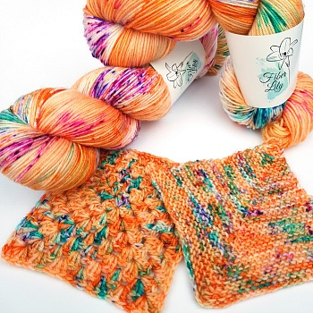 Jitterbug Fleur hand dyed yarn by Fiber Lily Australia orange with citrus, berry and turquoise speckles for knit and crochet swatch