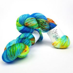 Just keep swimming blue, yellow, green and orange hand dyed yarn wool by Fiber Lily Australia speckled variegated colourway for knitting and crochet