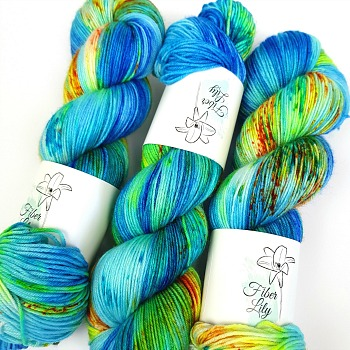 Just keep swimming blue, yellow, green and orange hand dyed yarn wool by Fiber Lily Australia speckled variegated colourway for knitting and crochet 3