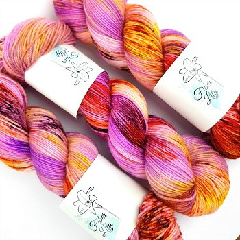 Tropicana pink purple, yellow, burnt orange hand dyed yarn wool by Fiber Lily Australia speckled variegated colourway for knitting and crochet 1