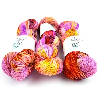 Tropicana pink purple, yellow, burnt orange hand dyed yarn wool by Fiber Lily Australia speckled variegated colourway for knitting and crochet
