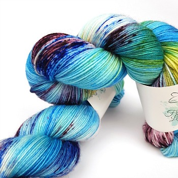 Bugle Fairy A Fiber Lily hand dyed yarn Australia Flower Fairies colourway blue, green and burgundy variegated colourway with speckles 3