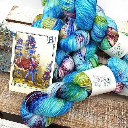 Bugle Fairy A Fiber Lily hand dyed yarn Australia Flower Fairies colourway blue, green and burgundy variegated colourway with speckles