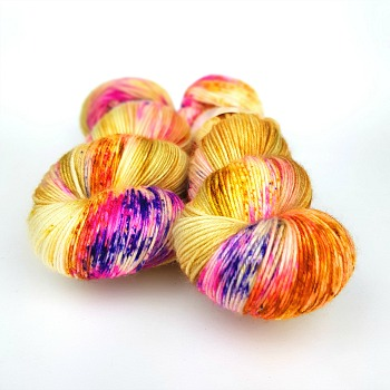 Butterfly Effect hand dyed yarn by Fiber Lily Australia gold base with hot pink, purple, orange and yellow speckles wool for knit and crochet